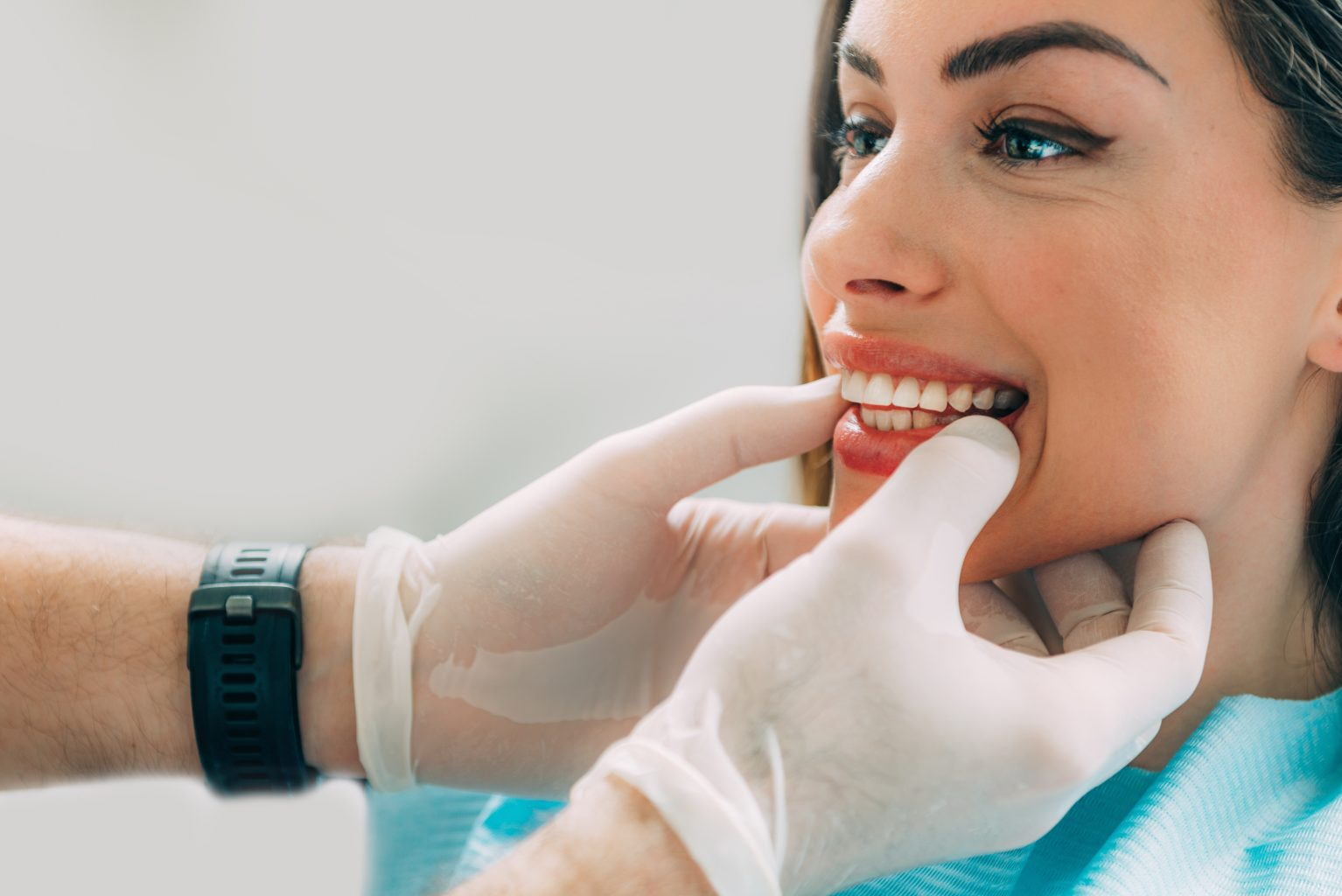Dentist With Beautiful Female Patient