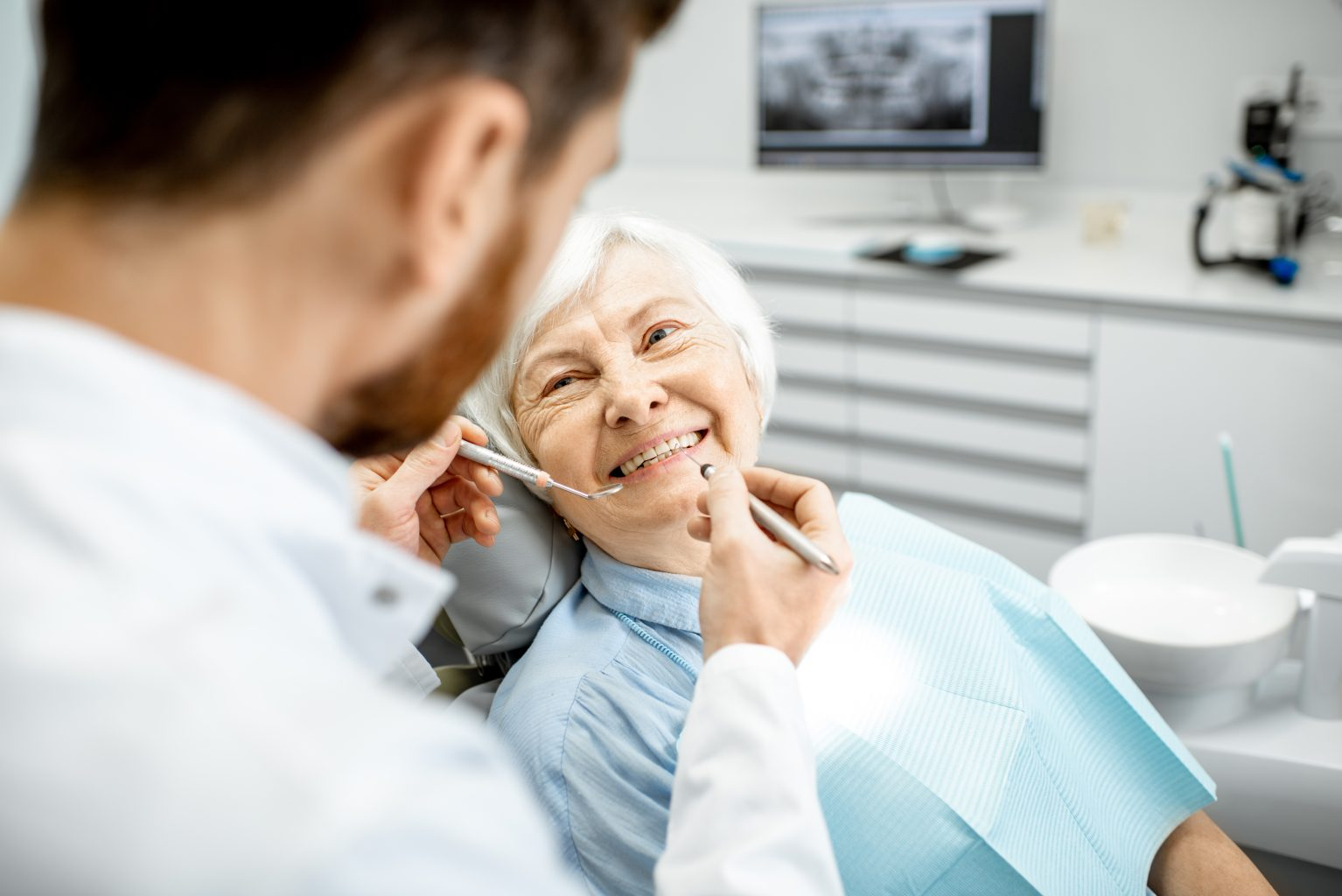 Elderly Woman During The Medical Examination With Dentist
